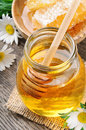 Glass honey pot and comb Royalty Free Stock Photo