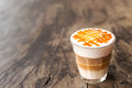 Glass of hot caramel macchiato coffee Royalty Free Stock Photo
