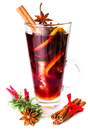 Glass with hot red mulled wine for winter and christmas with ora spices orange slice anise cinnamon sticks isolated on white Stock Photo