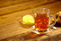 Glass of hot tea on wooden table rustic Royalty Free Stock Image