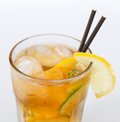 Glass of ice tea with cubes on white background Royalty Free Stock Image