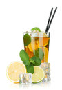 Glass of ice tea with lemon, lime and mint Royalty Free Stock Image