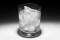 Glass of ice water with condensation in black and white Royalty Free Stock Photo