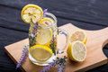 A glass infused water of lemon and lavender Royalty Free Stock Photo