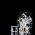 Glass Isolated on Black Background with ice cubes Royalty Free Stock Photo