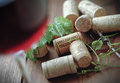 Glass of italian red wine with corks Royalty Free Stock Photo