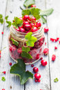 Glass jar fruits cherries currants Royalty Free Stock Photo