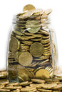 Glass jar full of twenty euro coins concept saving money close up macro shot Royalty Free Stock Image