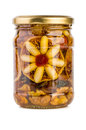 Glass jar with honey and nuts filled fruits isolated on white Royalty Free Stock Image