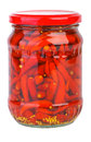 Glass jar with marinated red chili Stock Image