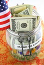 Glass jar marked made china dollar bills american flag oriental cushion Stock Image