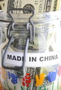 Glass jar marked made china dollar bills oriental cushion Stock Photography