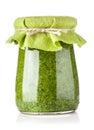 Glass jar of pesto sauce Royalty Free Stock Photo
