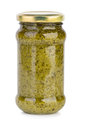 Glass jar with pesto sauce isolated on the white background Royalty Free Stock Images