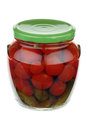 Glass jar with pickled cucumbers and tomatoes over white background Stock Images