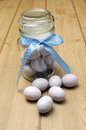 Glass jar of sugar candy mini Easter eggs Stock Photo