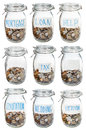 Glass jars with coins for different occasions closed saved money isolated on white background Stock Image