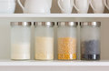 Glass jars with grain on the shelf Stock Image