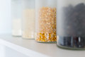 Glass jars with grain on the shelf Stock Photography