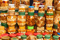 Glass jars nuts honey counter market as background Royalty Free Stock Photos