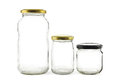 Glass jars three empty on white Stock Images