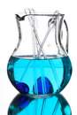Glass jug blue water reflection mirror white background Stock Images