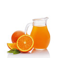 Glass jug of juice with slice of orange Royalty Free Stock Photo