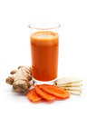 Glass of juice fresh ginger carrot and apple on a white background Royalty Free Stock Photos