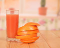 Glass of juice grapefruit sliced ​​rings and stacked in the kitchen Stock Photos