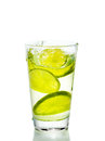 Glass with juice and lemon on the white background Royalty Free Stock Images