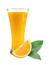 Glass of juice, orange slice with leaves on white
