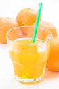 Glass of juice and  oranges on table Royalty Free Stock Photo