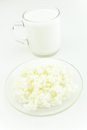 Glass of kefir and kefir grains on white background Royalty Free Stock Image