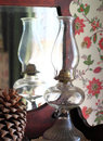 Glass kerosene lamp antique in front of a dresser mirror Royalty Free Stock Image