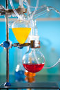 Glass laboratory apparatus with liquid samples Stock Images