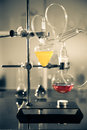 Glass laboratory apparatus with liquid samples Stock Photos