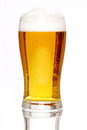 Glass of lager with a white background and white floor support Royalty Free Stock Photography