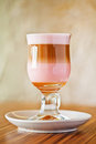 Glass of latte macchiato with grenadine syrup Stock Image
