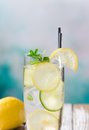 Glass of lemon limonade on wooden table Royalty Free Stock Images