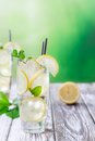 Glass of lemon limonade on wooden table Royalty Free Stock Photos