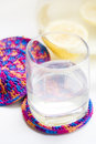 Glass with lemonade of on cup coaster carafe next to it Royalty Free Stock Images