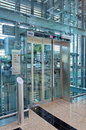 Glass lift lobby in airport building Stock Photography