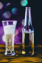 Glass of light beer with bubbles Royalty Free Stock Photo