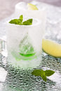 Glass made of ice with vodka, lemon and mint Royalty Free Stock Photo