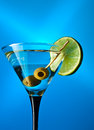Glass with martini and green olives Royalty Free Stock Photo