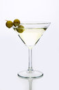 Glass martini with olive  light background Royalty Free Stock Photo