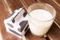 Glass of milk, a carton of milk. Royalty Free Stock Photo
