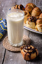 Glass of milk with cinnamon rolls Royalty Free Stock Photo