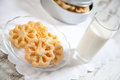 Glass of milk and cookies on a plate. Royalty Free Stock Images