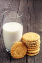 Glass of milk and cookies on vintage wooden table Royalty Free Stock Image